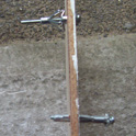 Hollow wall anchors in board