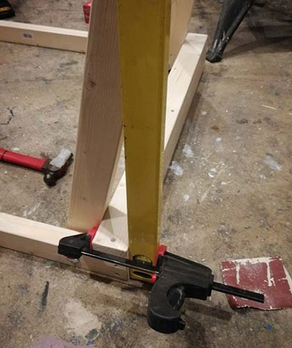Straight edge clamped to back of frame