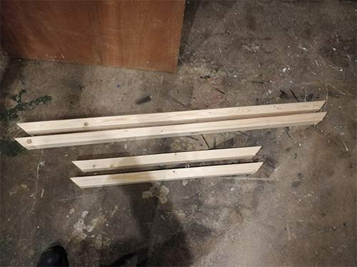 Framework timber cut to size and mitred at each end
