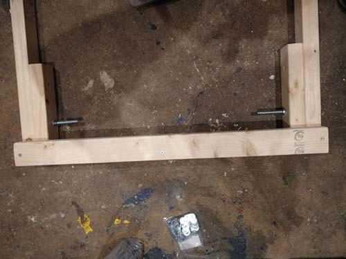 Leg stay screwed to underside of workbench