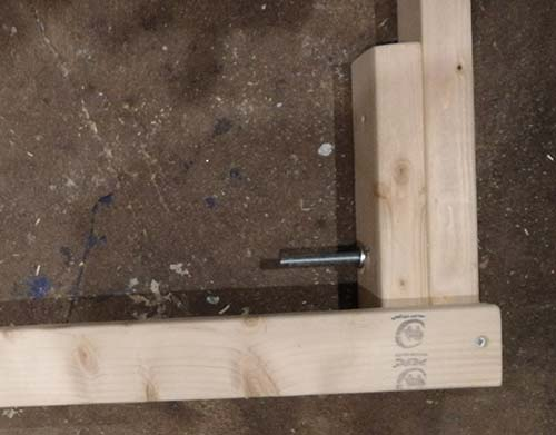 Timber chocks screwed at one end of frame
