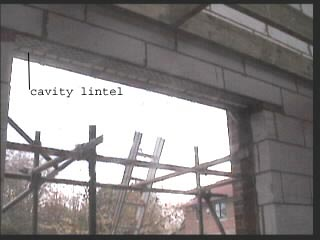 Patio opening with cavity lintel