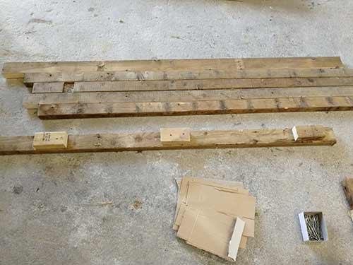 Timber chocks screwed to each racking leg