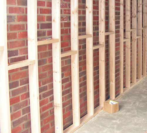 Battening walls for insulating