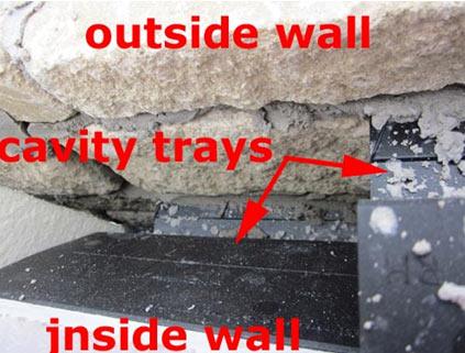 Cavity trays stop damp running down cavity