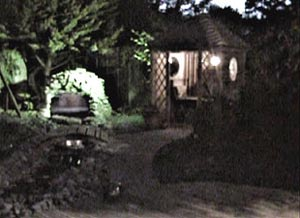 The cave, waterfalls and summer house lit up at night