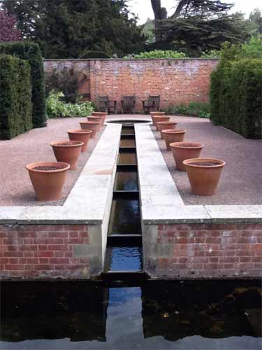 Formal water garden with cascade