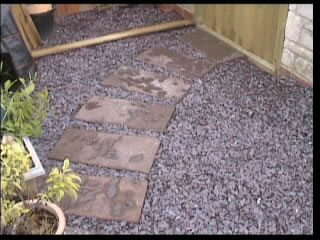 Scalpings layed and paving slabs laid for pathway