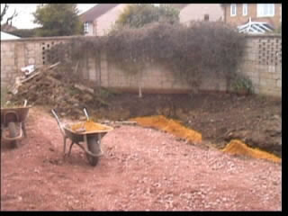 Clearing the area for laying path and driveway