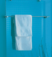 Glass radiator covered by towel rail