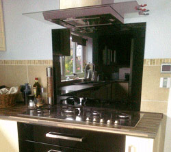 Glass splashback over cooker and worktop