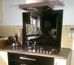 Glass splashback over cooker and worktop