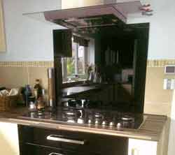 Acrylic splashback fitted behind cooker in kitchen