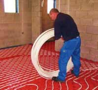 Underfloor heating system pipework being layed