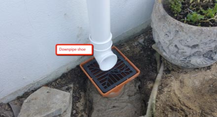 Shoe fitted to base of downpipe