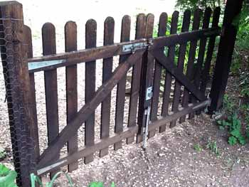Double wooden picket garden gate