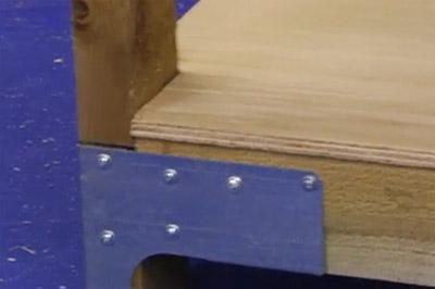 Screwing down shelf to rails