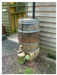 Wooden barrel style water butt