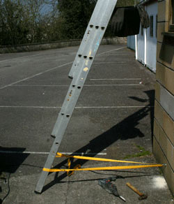 Ladder safely secured to wall