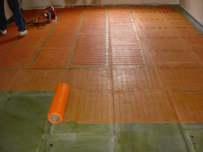 Laying heating elements onto floor