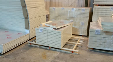 Stacks of different sized Foil Backed insulation sheets for floor slabs