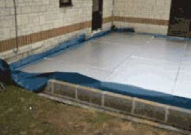 Poring a concrete floor slab over the insulation