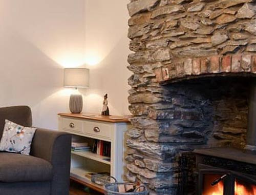 Rustic cottage with exposed stone chimney breast