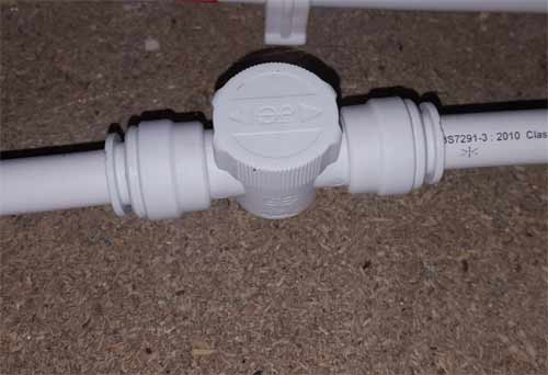 Push fit isolation valve fitted