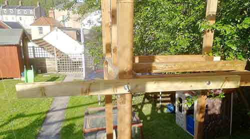 Balcony support timber bolted in place