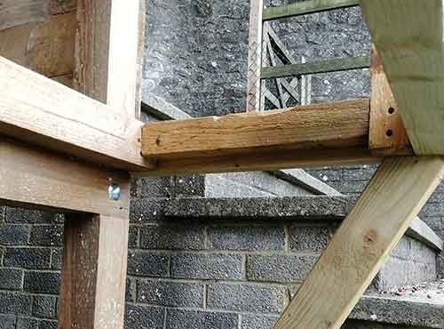 Framework fixed inside balcony to support floor