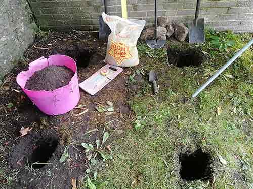 Post holes dug to 450mm deep