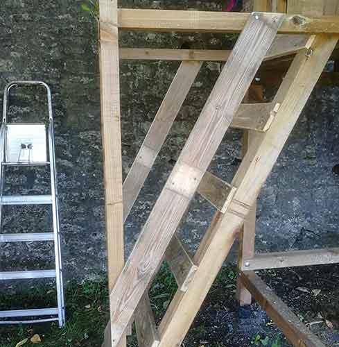 Pallet slats added to sides of ladder