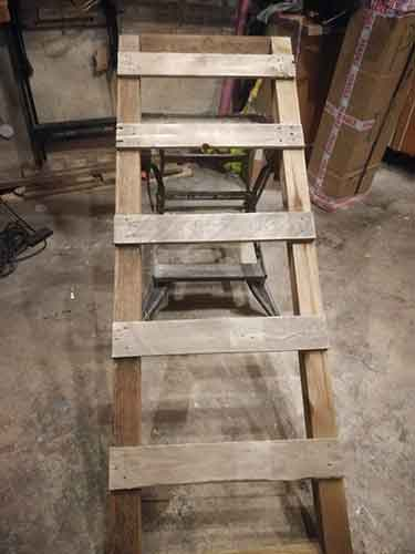Playhouse ladder created using pallet slats