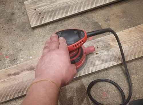 Sanding down pallet slats for doors