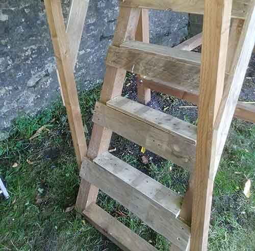Treads screwed to playhouse ladder