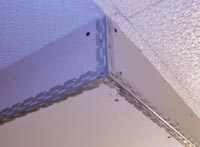 Closeup of corner beads on kitchen lighting box