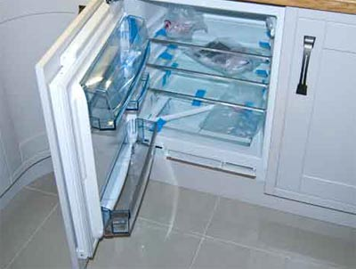 Fridge set into integrated kitchen unit