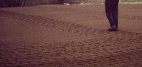 Treading down soil to lay new turf