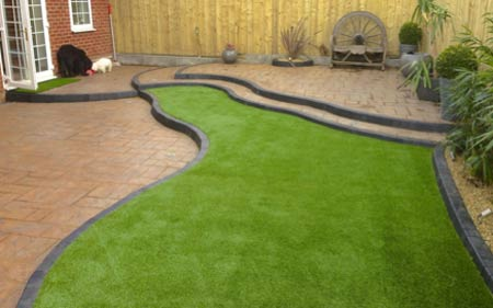 Laying artificial grass on hard surface