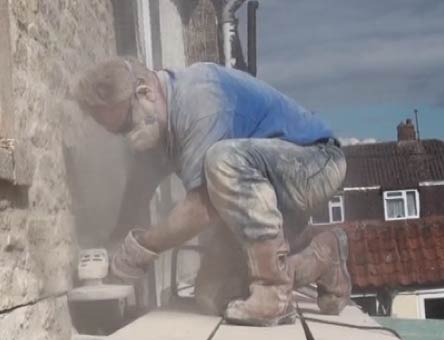 Cutting a lead chase in stonework
