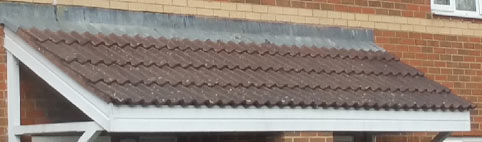 Lead flashing on a long porch roof dressed over tiles