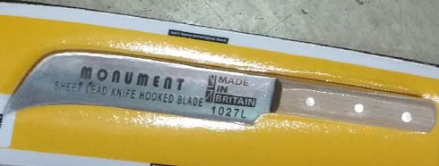 Sheet lead knife with hooked blade