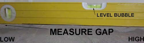 Using a spirit level to check the level of a floor