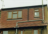 Completed loft conversion, building inspector checked final items and scaffolding removed<
