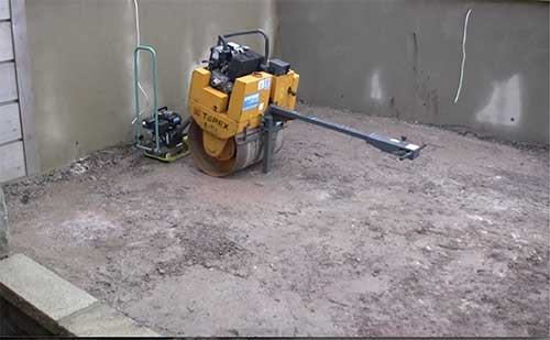 Compacting sub base using single drum roller
