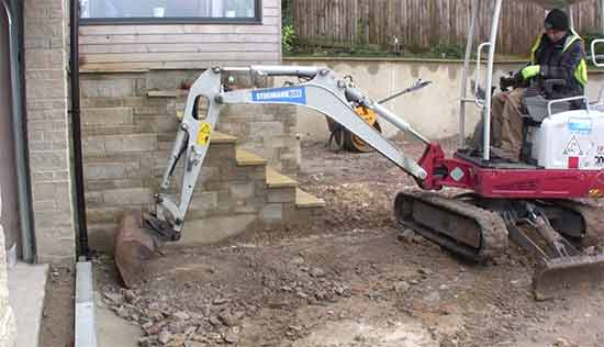 Clearing existing drive surface with mini digger