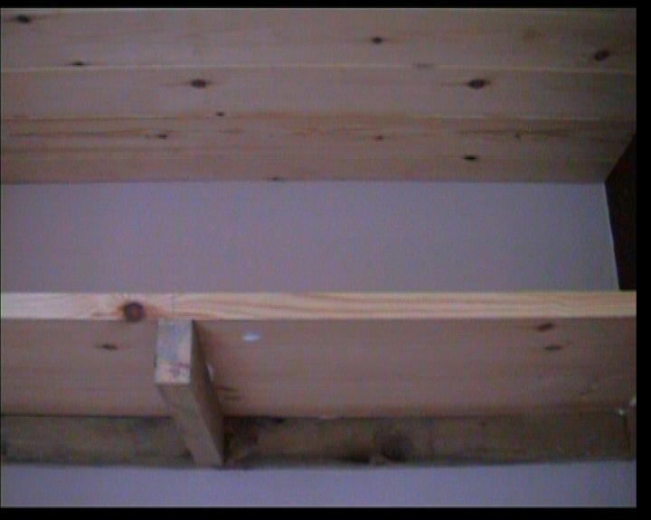 Close up of Shelving showing supporting strut added to centre
