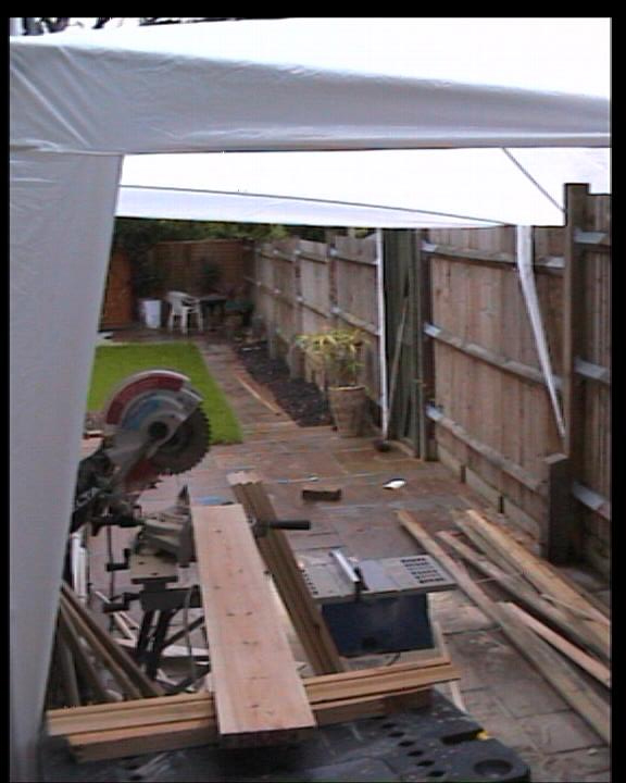 Chop Saw and Table Saw situated outside with awning covering it