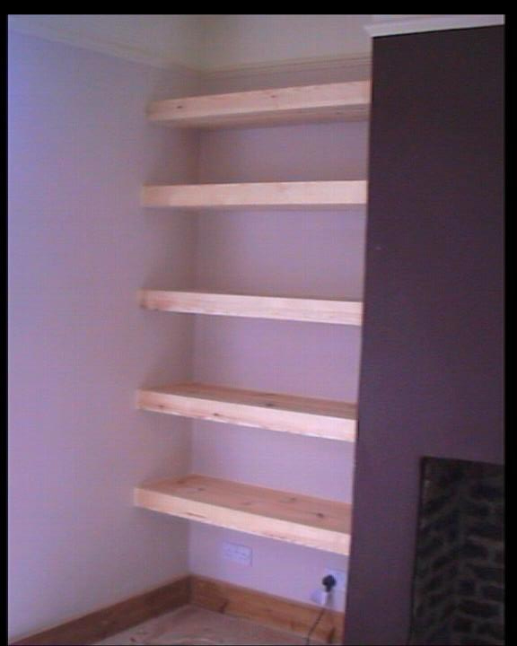 Finished shelving job with shelves added to alcove area to the side of a chimney breast