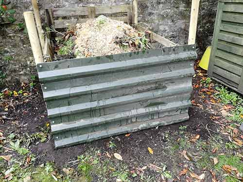 Front roof sheet fixed to compost heap posts